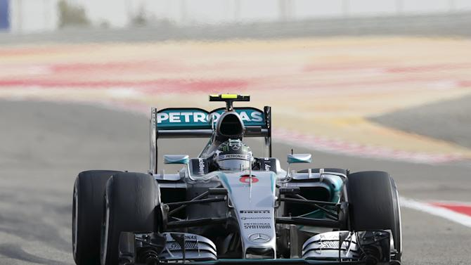Mercedes Formula One Driver Rosberg of Germany returns to the pit lane during the third free practice ahead of Bahrain's F1 Grand Prix at Bahrain International Circuit, south of Manama