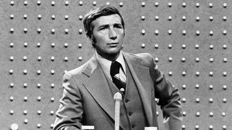 "FILE - This June 1978 file photo shows Richard Dawson, host of ""Family Feud"" in character. Dawson, the wisecracking British entertainer who was among the schemers in the 1960s sitcom ""Hogan's Heroes"" and a decade later began kissing thousands of female contestants as host of the game show ""Family Feud"" died Saturday, June 2, 2012. He was 79. (AP Photo, File)"