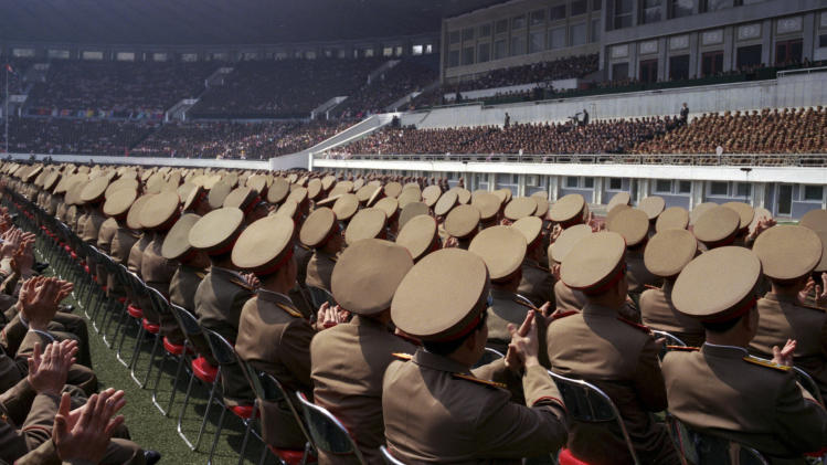 In this April 14, 2012, photo, North Korean military members applaud the country's leaders, including Kim Jong Un, from their seats on the field of a stadium in Pyongyang during a mass meeting called by North Korea's ruling party. (AP Photo/David Guttenfelder)