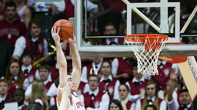 Indiana's Will Sheehey (0) is fouled by Nebraska's Andre Almeida (32) as he dunks the ball during the first half of an NCAA college basketball game, Wednesday, Feb. 13, 2013, in Bloomington, Ind. (AP Photo/Doug McSchooler)