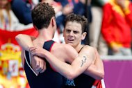 Alistair Brownlee (L) and Jonathan Brownlee celebrate after winning the gold and bronze medal in the Men's Triathlon (Getty Images)