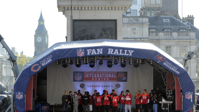 Members of the Tampa Bay team wave to fans during a fan rally at Trafalgar Square, London, Saturday Oct. 22, 2011. The Buccaneers will face Chicago Bears at London's Wembley stadium on Sunday as part of the NFL International series. (AP Photo/Tom Hevezi)