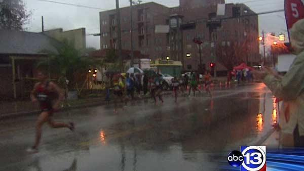 Marathon runners persevere through rain, cold