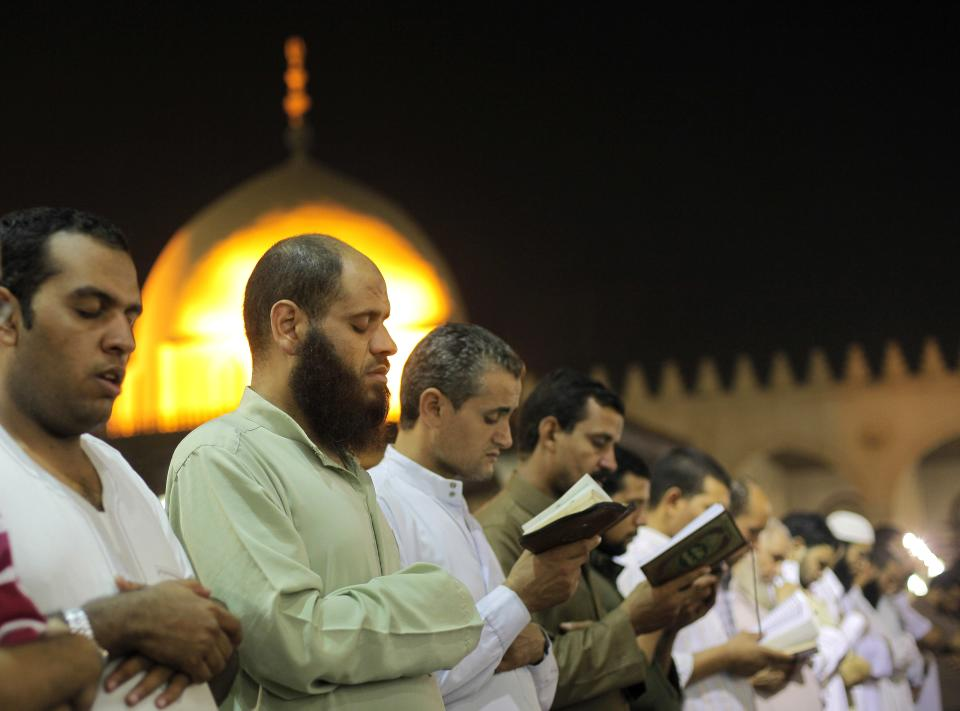 Egyptian Muslims offer special prayers marking Laylat al-Qadr, Night of Power, at Amr Ibn Al-As mosque in Cairo, Egypt,  early Wednesday, Aug. 15, 2012.  Muslims Seek Laylat al-Qadr in the odd nights during the last ten nights of Ramadan.  (AP Photo/Amr Nabil)