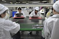 File photo shows Chinese workers at the Foxconn factory in Shenzhen, in southern China's Guangdong province. New York-based China Labor Watch last month said an investigation of 10 suppliers to Apple in southern and eastern China uncovered violations of workers' rights, including excessive overtime and dangerous conditions