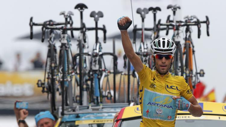 Race leader Astana team rider Nibali of Italy celebrates as he crosses the finish line to win the 145.5km 18th stage of the Tour de France cycling race between Pau and Hautacam