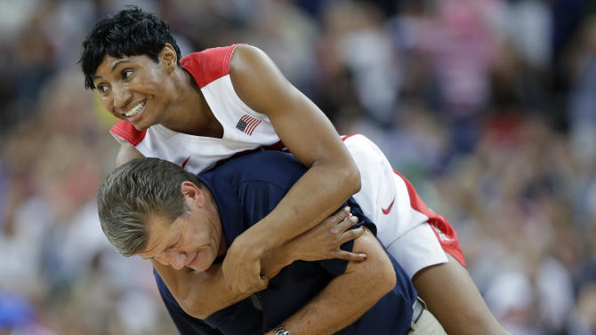 United States' Angel McCoughtry jumps on the back of United States coach Geno Auriemma following their win over France in the women's gold medal basketball game at the 2012 Summer Olympics, Saturday, Aug. 11, 2012, in London. (AP Photo/Eric Gay)