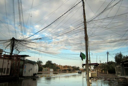 Tangled electrical wires over a flooded street in the Iraqi capital Baghdad on December 26, 2012. The worst rains to hit Baghdad in 30 years left four people dead and many of the Iraqi capital's residents struggling to cope with heavy flooding on Wednesday as the government declared a national holiday