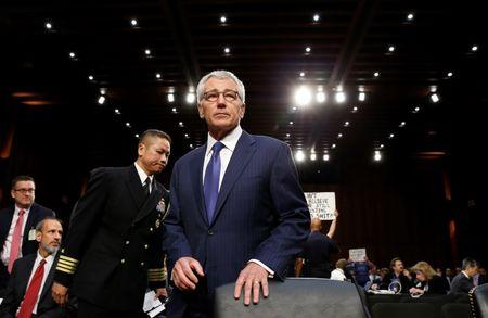 Hagel takes his seat to testify at the Senate Armed Services Committee hearing on the U.S. policy toward Iraq and Syria and the threat posed by the Islamic State, on Capitol Hill in Washington