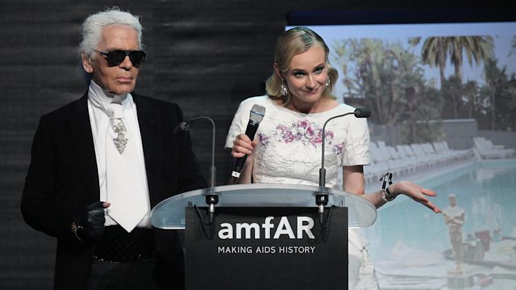 Karl Lagerfeld and Diane Kruger during the auction for the amfAR Cinema Against AIDS benefit during the 65th Cannes film festival, in Cap d'Antibes, southern France, Thursday, May 24, 2012. (AP Photo/Joel Ryan)