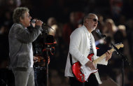 The Who guitarist Pete Townsend, right, and singer Roger Daltrey perform during the Closing Ceremony at the 2012 Summer Olympics, Monday, Aug. 13, 2012, in London. (AP Photo/Matt Slocum)