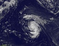 This visible image of Tropical Storm Nadine was captured by NOAA&#39;s GOES-13 satellite at 1445 UTC (10:45 a.m. EDT) on Sept. 12, 2012. The image shows that Nadine is developing a central dense overcast and bands of thunderstorms all around the st