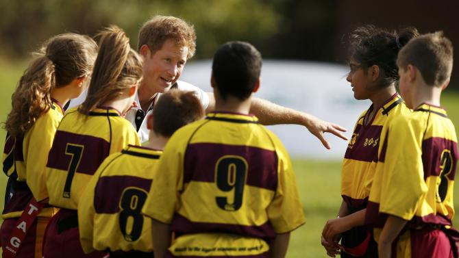 Britain's Prince Harry takes part in a training session during his visit to a All Schools Programme at Eccles Rugby Football Club in Eccles