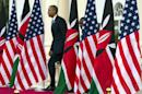 FILE - In this July 25, 2015 file photo, President Barack Obama and Kenyan President Uhuru Kenyatta arrive for a news conference at State House in Nairobi, Kenya, where President Obama nudged African nations to treat gays and lesbians equally under the law, a position that remains unpopular through much of the continent. The U.S. has deployed its diplomats and tens of millions of dollars to try to block anti-gay laws, punish countries that enacted them, and tie U.S. assistance to respect for LGBT rights, animated in part by former Secretary of State Hillary Clinton?s declaration that ?gay rights are human rights.? (AP Photo/Evan Vucci, File)