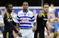 Queens Park Rangers' defender Anton Ferdinand (2nd L) is seen with Chelsea's defender John Terry (R) during their English Premier League football match at Loftus Road in London. The match ended in a 0-0 draw