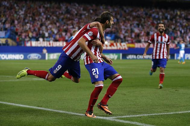 Atletico Madrid's Leonardo Baptistao from Brazil celebrates after scoring a goal during a Group G Champions League soccer match against Zenit St. Petersburg at the Vicente Calderon stadium in in Madri