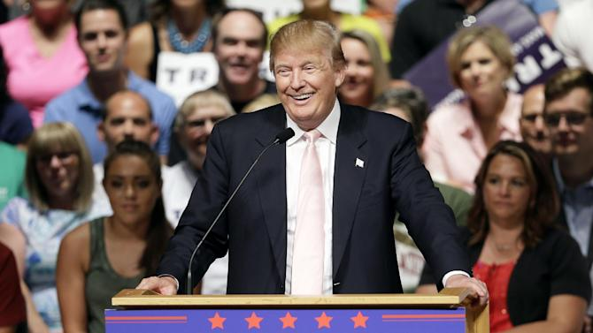 FILE - In this July 25, 2015 file photo, Republican presidential candidate Donald Trump speaks at a rally and picnic in Oskaloosa, Iowa. Since the beginning of June, Donald Trump has received more coverage on the broadcast network evening newscasts than all of the other candidates for president combined. The ABC, CBS and NBC evening newscasts spent 114 minutes on campaign coverage from the beginning of June through the end of last week, and Trump was the focus of 60 of them. (AP Photo/Charlie Neibergall, File)