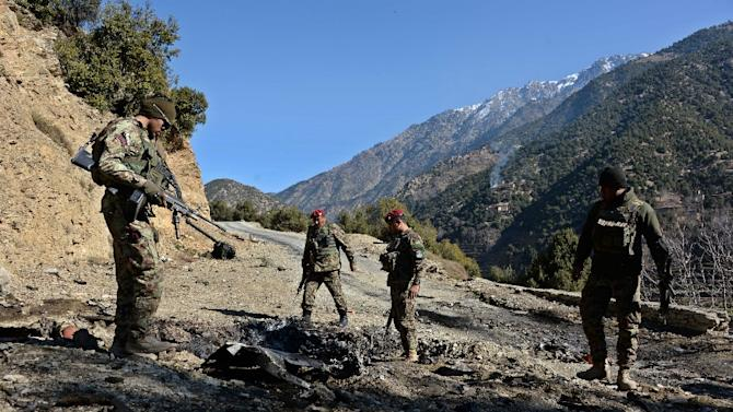 Afghan security personnel patrol during an ongoing anti-Taliban operation in Dangam district near the Pakistan-Afghanistan border on January 17, 2015