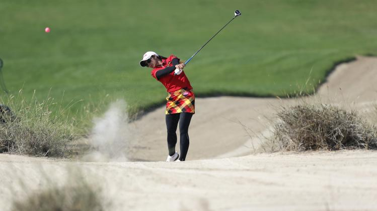 Pornanong Phatlum of Thailand hits the ball on the 14th hole during the Dubai Ladies Masters golf tournament in Dubai