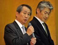 This file photo shows Kenichi Watanabe (L), Nomura Holdings CEO, and Koji Nagai, Nomura Securities president, during a briefying in Tokyo, in June. The head of Japan's biggest securities firm resigned on Thursday in the wake of an embarrassing insider trading scandal, part of a widening national probe into the widespread practice