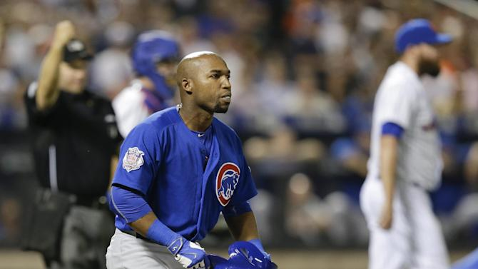 Chicago Cubs' Jonathan Herrera reacts after a ball he bunted was caught for an out by New York Mets relief pitcher Bobby Parnell during the eighth inning of a baseball game Wednesday, July 1, 2015, in New York. (AP Photo/Frank Franklin II)