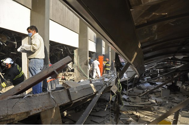 Firefighters belonging to the Tacubaya sector and workers dig for survivors after an explosion at a building adjacent to the executive tower of Mexico's state-owned oil company PEMEX, in Mexico City,