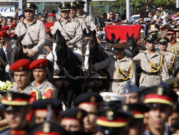 A horse drawn caisson carries the remains of Egypt's former spy chief Omar Suleiman during his funeral in Cairo, Egypt, Saturday, July 21, 2012. The 76-year-old Suleiman died Thursday in a U.S. hospital. The shadowy statesman was considered Mubarak's most trusted man, handing the regime's most sensitive issues like relations with the U.S. and Israel and the fierce battle against Islamists. (AP Photo/Amr Nabil)