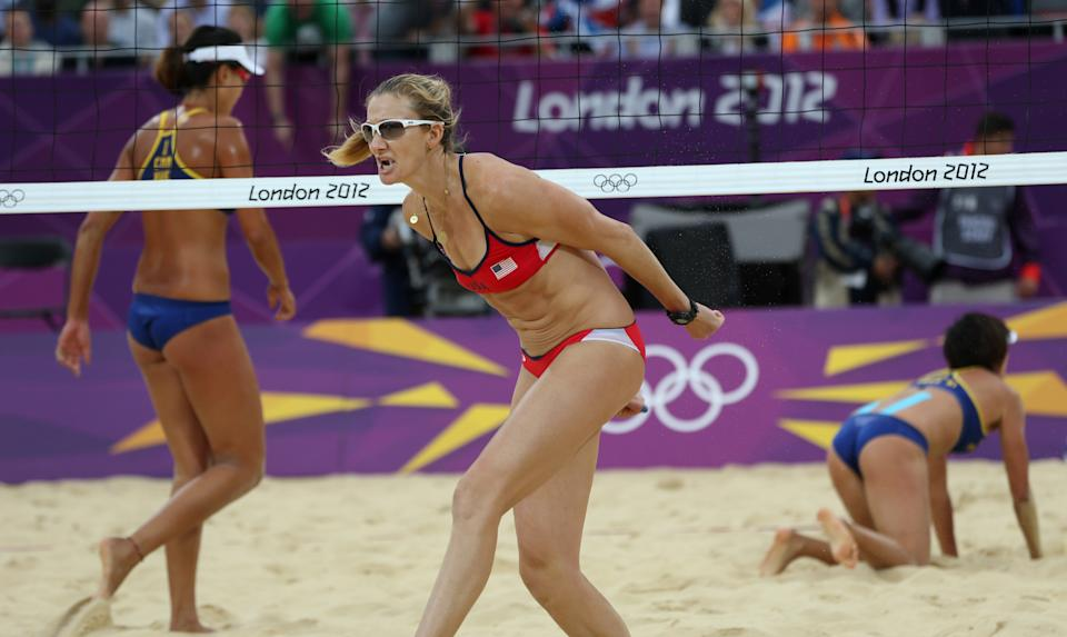 China's Xi Zhang, right, Xue Chen, left, and US Misty Kerri Walsh Jennings, center, react during their semifinal women's beach volleyball match at the 2012 Summer Olympics, Tuesday, Aug. 7, 2012, in London. (AP Photo/Petr David Josek)
