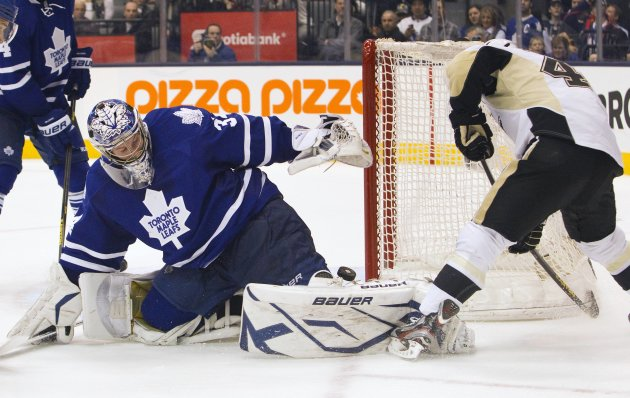 Toronto Maple Leafs' Reimer watches puck hit pad on shot by Pittsburgh Penguins' Kennedy during their NHL hockey game in Toronto