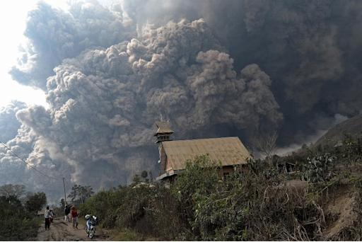A giant cloud of hot volcanic ash clouds engulfs villages in Karo district during the eruption of Mount Sinabung volcano, on Indonesia's Sumatra island, on February 1, 2014