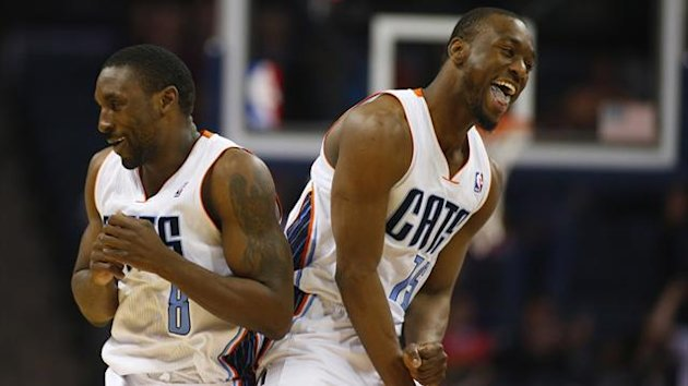 Charlotte Bobcats point guard Kemba Walker (R) and shooting guard Ben Gordon (L) celebrate after a basket (Reuters)