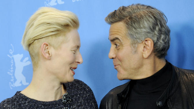 Actors Clooney and Swinton pose during photocall at 66th Berlinale International Film Festival in Berlin