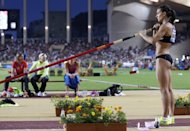 This file photo shows Russian athlete Yelena Isinbayeva preparing to compete in the women's pole vault event during the IAAF Diamond League Herculis meeting at the Stade Louis II in Monte Carlo, Monaco, on July 20. Isinbayeva will on Saturday bid to safely negotiate London Olympics' qualifying for Monday's final