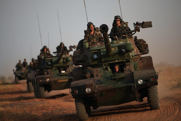 French soldiers patrol in armored vehicles, in the outskirts of Sevare, Mali, some 620 kms (385 miles) north of Bamako, Wednesday, Jan. 23, 2013. The U.S. airlift of French forces to Mali to fight Isl