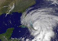 "This satellite image from the NOAA shows Hurricane Sandy churning its way through the Caribbean. Sandy pounded the Bahamas on Thursday, and headed toward the US East Coast on a path which forecasters warned could lead to the creation of a powerful hybrid ""Frankenstorm"" next week"