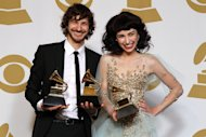 Gotye, left, and Kimbra pose backstage with the award for best pop duo/group performance for &quot;Somebody That I Used to Know&quot; at the 55th annual Grammy Awards on Sunday, Feb. 10, 2013, in Los Angeles. (Photo by Matt Sayles/Invision/AP)