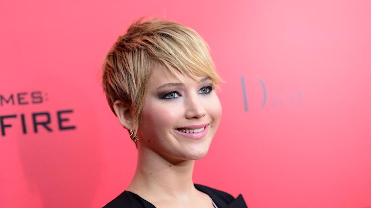 "FILE - This Nov. 20, 2013 file photo shows actress Jennifer Lawrence sporting a pixie haircut at a special screening of ""The Hunger Games: Catching Fire""in New York. (Photo by Evan Agostini/Invision/AP, File)"