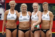 LONDON, ENGLAND - MAY 24:  Members of Great Britain women&#39;s Beach Volleyball team (L-R) Denise Johns, Lucy Bolton, Shauna Mullin and Zara Dempne take part in a &#39;Stop Traffic&#39; photocall on Parliament Square on May 24, 2012 in London, England. The PR stunt was aimed at reminding commuters that roads were likely to be busier at peak times during the 2012 London Olympic Games.  (Photo by Dan Kitwood/Getty Images)