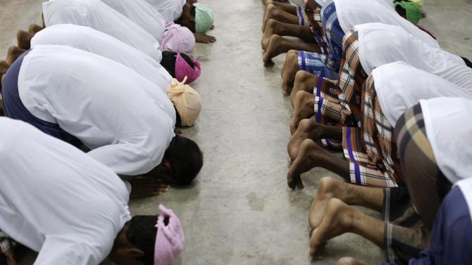 Suspected victims of human trafficking pray at a government shelter in Takua Pa