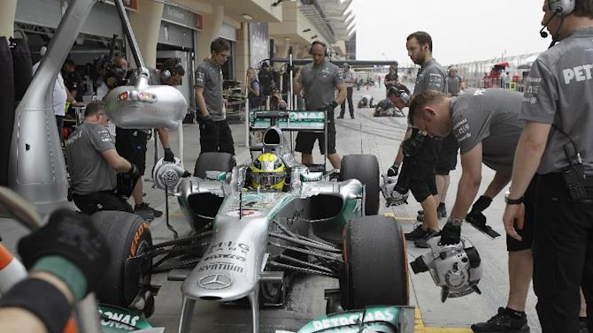 Mercedes mechanics receive the car of Mercedes driver Nico Rosberg of Germany in the pit during the third practice session of the Bahrain Formula One Grand Prix at the Bahrain International Circuit in Sakhir, Bahrain, Saturday, April 20, 2013. The Bahrain Formula One Grand Prix will take place on Sunday. (AP Photo/Kamran Jebreili)