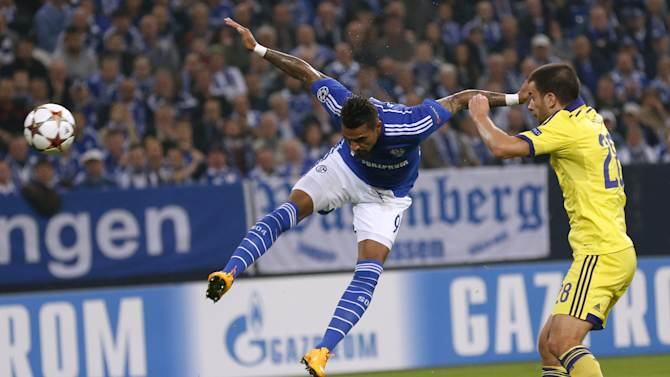 Schalke 04's Boateng heads ball next to Maribor's Viler during their Champions League soccer match in Gelsenkirchen