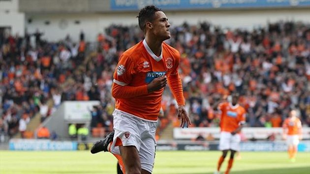 Tom Ince's late goal sent Blackpool top