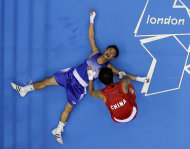 Thailand's Kaeo Pongprayoon, in blue, lies on the mat after losing to China's Zou Shiming in the men's light flyweight 49kg boxing gold medal match at the 2012 Summer Olympics, Saturday, Aug. 11, 2012, in London. (AP Photo/Mark Duncan)