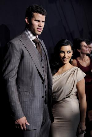 FILE - In this Aug. 31, 2011 file photo, newlyweds Kim Kardashian, right, and Kris Humphries attend a party thrown in their honor in New York. Kardashian is expected to file for divorce in Los Angeles on Monday, Oct. 31, 2011, according to a report confirmed by the producers of her reality show. Kardashian and Humphries were married on Aug. 20. (AP Photo/Evan Agostini, file)