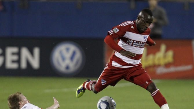New York Red Bulls' Dax McCarty (11) clears the ball away from FC Dallas defender Jair Benitez in the first half of an MLS Cup first-round soccer match on Wednesday, Oct. 26, 2011, in Frisco, Texas. (AP Photo/Tony Gutierrez)