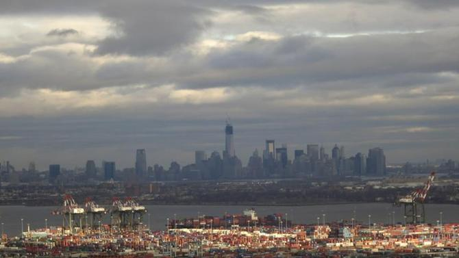 The skyline of Lower Manhattan in New York is seen behind the shipping docks in Newark, New Jersey