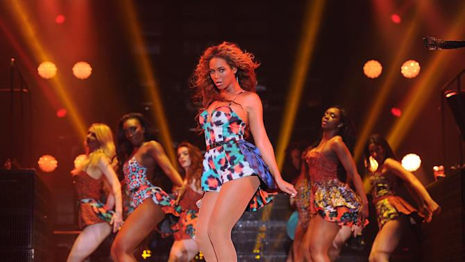 """Singer Beyonce performs the song """"Grown Woman"""" on her """"Mrs. Carter Show World Tour 2013"""", on Wednesday, April 24, 2013 at the Palais Omni Sport Bercy in Paris, France. Beyonce is wearing a custom printed romper with bustle by designer Kenzo. (Photo by Frank Micelotta/Invision for Parkwood Entertainment/AP Images."""