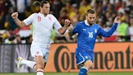 England's Andy Carroll and Italy's Daniele De Rossi vie for the ball