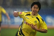 Japan and Borussia Dortmund star Shinji Kagawa (pictured in 2010) is back on Manchester United&#39;s radar after returning from a four-month layoff with a foot injury, according to a report. Sir Alex Ferguson&#39;s side are planning to send a team of scouts to follow the 22-year-old attacking midfielder at Dortmund games next season, the Japanese daily Nikkan Sports said
