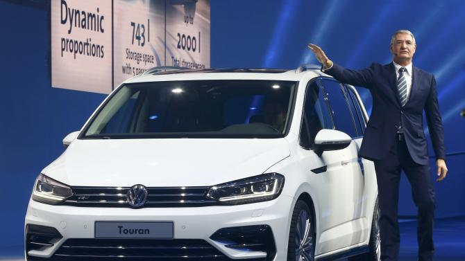 Neusser, VW Head of Technical Development, speaks next to a new Touran car during a Volkswagen Group event ahead of the 85th International Motor Show in Geneva